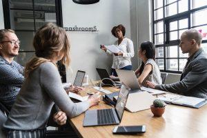 Team brainstorming in meeting - future leaders