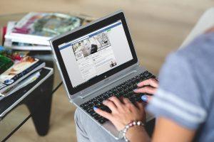 Looking at social media on laptop