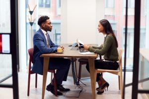 Employee receiving negative feedback at work