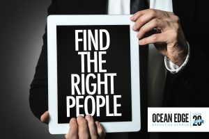 Hands holding sign saying 'Find the right people'